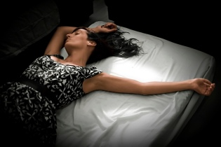 woman laying on bed awake