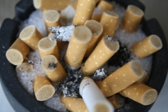 photo of cigarette stubs in ashtray