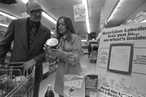 U. S. Department of Agriculture's helps educate shoppers about the value of food labeling in December 1975. Photo courtesy National Archives and Records Administration.