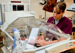a_nurse_examines_a_newborn_baby